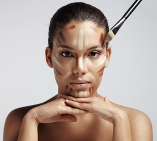 facial contouring. Woman with a different shades of foundation o